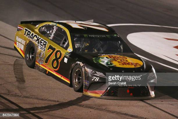 Martin Truex Jr drives the BassProShops/TrackerBoats 40th Anniversary Toyota during the Monster Energy NASCAR Cup Series Bojangles' Southern 500 at...