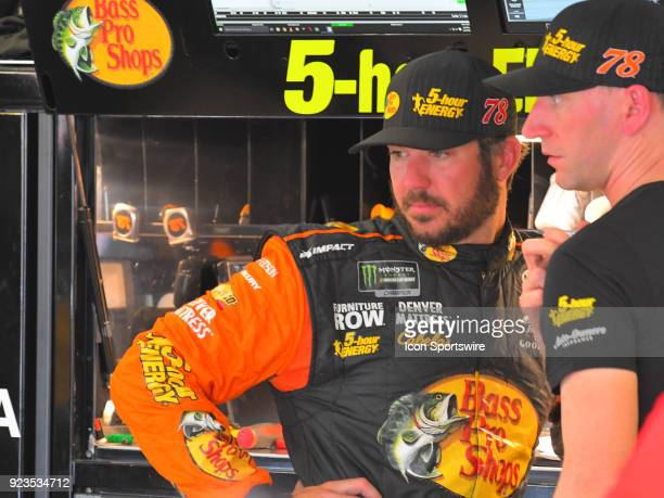 Martin Truex Jr Furniture Row Racing Bass Pro Shops/5hour ENERGY Toyota Camry talks to his crew chief Cole Pearn during practice for the Monster...