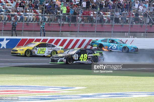 Martin Truex Jr Furniture Row Racing Toyota Camry AutoOwners Insurance and Jimmie Johnson Hendrick Motorsports Chevrolet Camaro Lowe's for Pros crash...