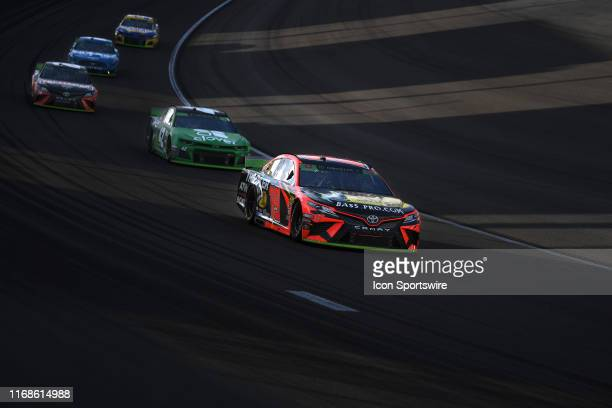 Martin Truex Jr Joe Gibbs Racing Toyota Camry leads others through turn one during the Monster Energy NASCAR Cup Series - South Point 400 at the Las...