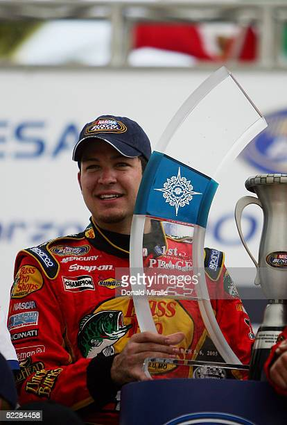 Martin Truex Jr. Of the U.S., driver of the Bass Pro Shops Chevrolet Monte Carlo, holds the winner's trophy after his victory in the Telcel Mexico...