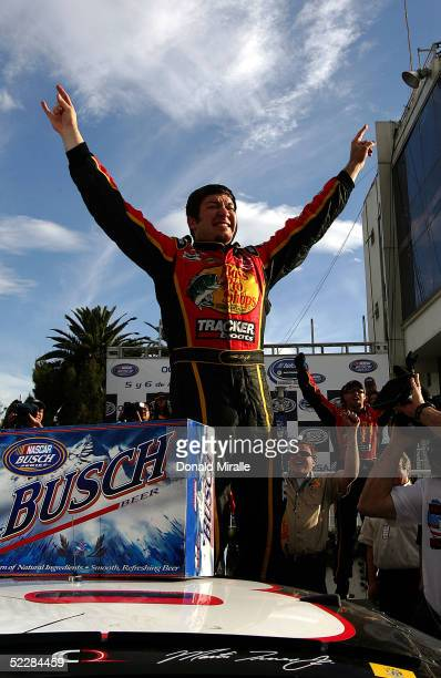 Martin Truex Jr. Of the U.S., driver of the Bass Pro Shops Chevrolet Monte Carlo, celebrates his victory during the Telcel Mexico 200 Nascar Busch...
