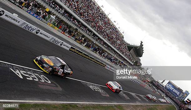 Martin Truex Jr. Of the U.S., driver of the Bass Pro Shops Chevrolet Monte Carlo, leads the pack en route to his victory during the Telcel Mexico 200...