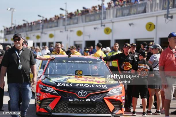 Martin Truex Jr's race car is pushed through the garage area before the Daytona 500 NASCAR race at Daytona International Speedway in Daytona Beach on...