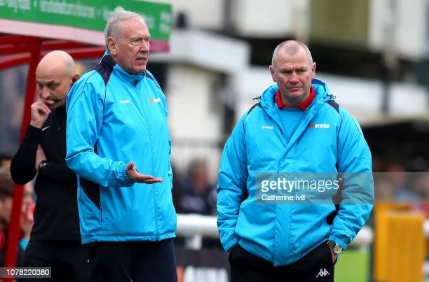 Martin Tyler first team coach of Woking and Alan Dowson manager of Woking look on during the FA Cup Third Round match between Woking and Watford at...