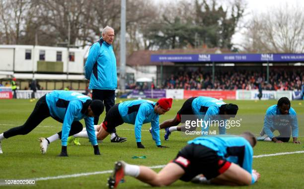 Martin Tyler leads the warm ups as firstteam coach prior to the FA Cup Third Round match between Woking and Watford at Kingfield Stadium on January 6...