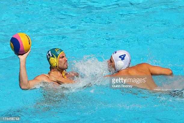 Martin Tyler of Australia in action against Bence Batori of Hungary during the Men's Water Polo first preliminary round match between Hungary and...