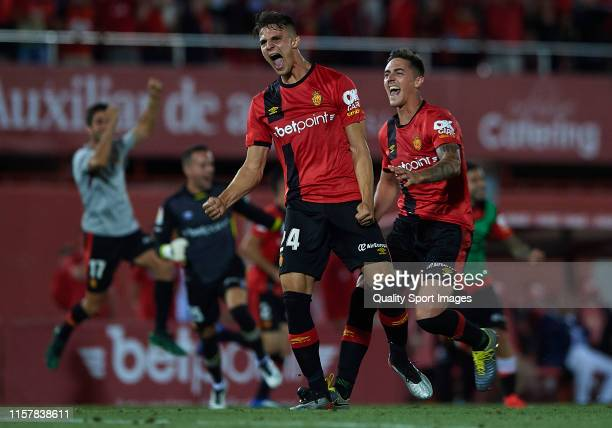Martin Valjent of Mallorca and Antonio Raillo of Mallorca celebrate after winning during the play off second leg match between Deportivo de La Coruna...