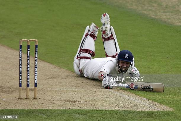Martin van Jaarsveld of Sussex dives to make his crease during day one of the Liverpool Victoria County Championship Division One match between Kent...