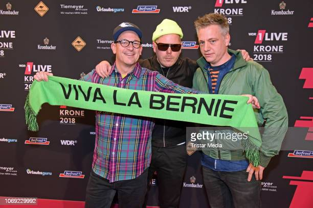 Martin Vandreier Boris Lauterbach and Bjoern Warns of the band Fettes Brot arrive at the 1Live Krone radio award red carpet at Jahrhunderthalle on...