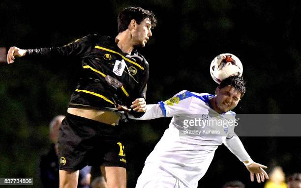 Martin Vasquez Gold Coast City and Corey Lucas of Moreton Bay compete for the ball during the FFA Cup round of 16 match between Moreton Bay United...