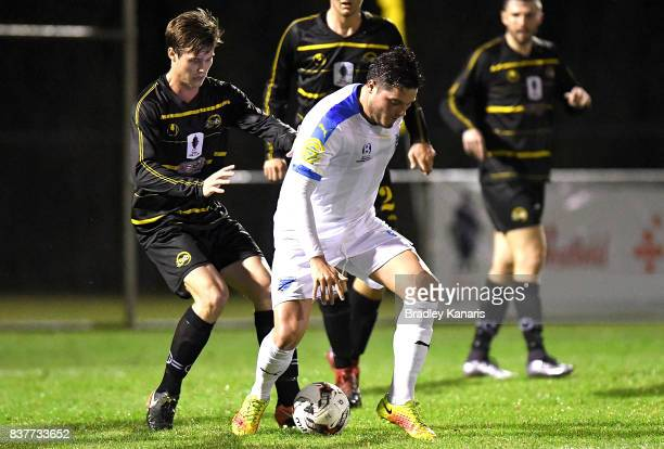 Martin Vasquez Gold Coast City is pressured by the defence during the FFA Cup round of 16 match between Moreton Bay United and Gold Coast City at...