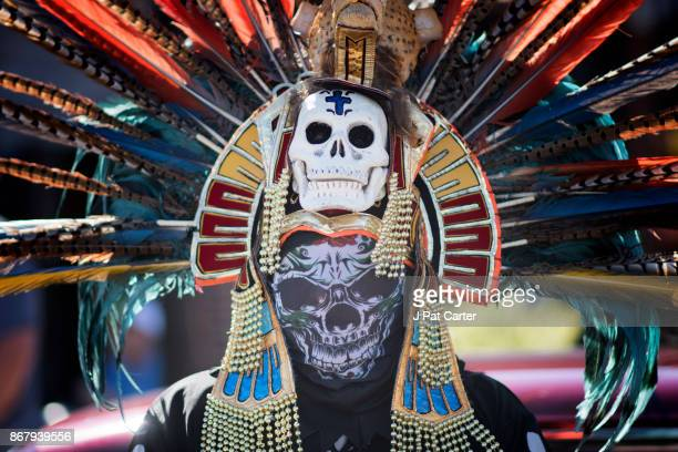 Martin Vera an Aztec dancer prepares for La Catrina procession as people celebrate the 4th annual Day of the Dead Festival on October 29 2017 in...