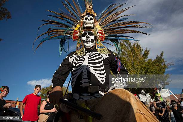 Martin Vera dressed in a traditional Aztec head dress joins in the processessional parade during the Dia de los Muertos celebration November 1 2015...