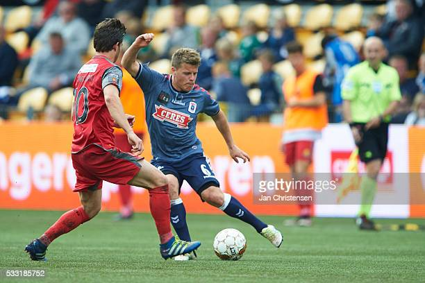 Martin Vingaard of FC Nordsjalland and Daniel Christensen of AGF Arhus compete for the ball during the Danish Alka Superliga match between FC...