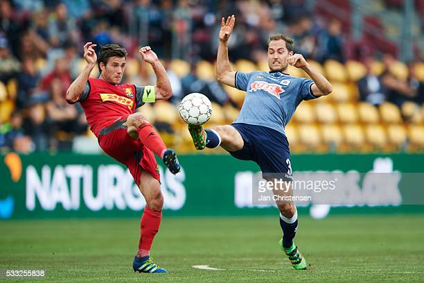 Martin Vingaard of FC Nordsjalland and Niklas Backman of AGF Arhus compete for the ball during the Danish Alka Superliga match between FC...