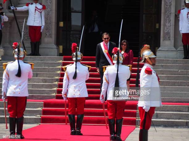 Martin Vizcarra and his wife Maribel Diaz in the honor courtyard of Government Palacereceives the salute from the palace guard after taking office as...