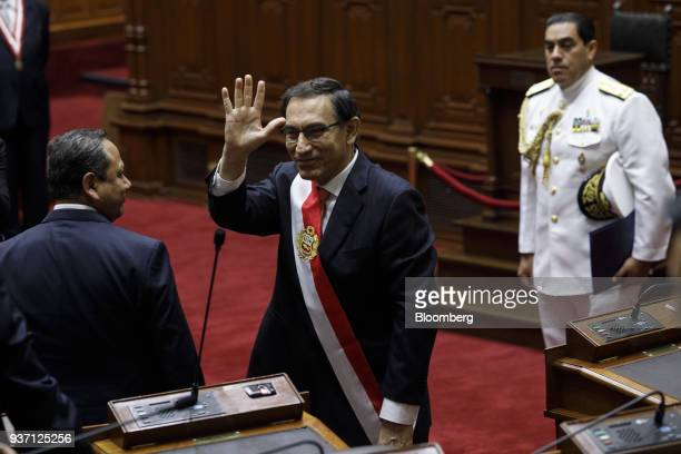 Martin Vizcarra Peru's president center waves after being sworn into office during a ceremony in Lima Peru on Friday March 23 2018 Vizcarra assumed...