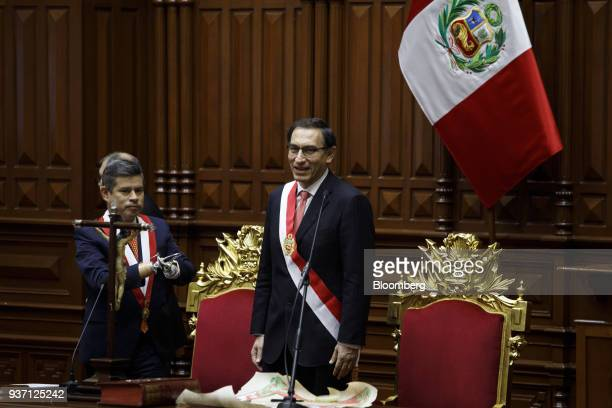 Martin Vizcarra Peru's president right smiles after being sworn into office during a ceremony in Lima Peru on Friday March 23 2018 Vizcarra assumed...