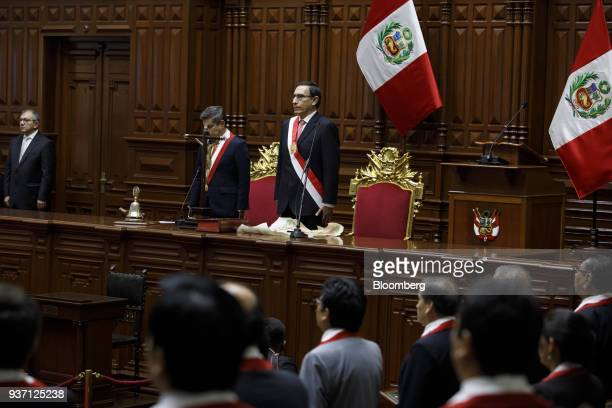 Martin Vizcarra Peru's president right stands for the national anthem during a swearing in ceremony in Lima Peru on Friday March 23 2018...