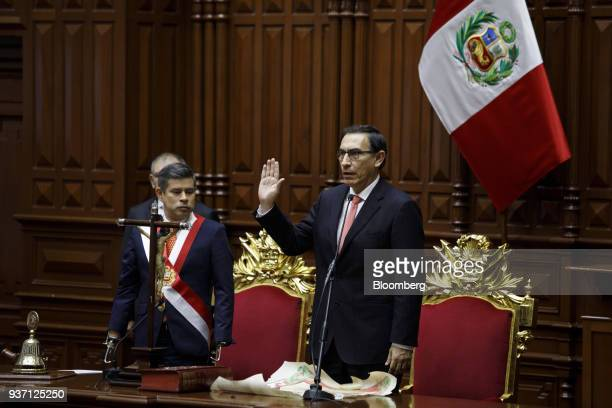 Martin Vizcarra Peru's president right swears into office during a ceremony in Lima Peru on Friday March 23 2018 Vizcarra assumed Peru's highest...