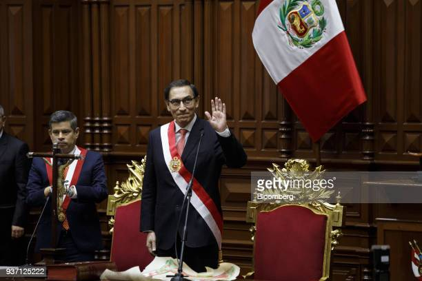 Martin Vizcarra Peru's president right waves after being sworn into office during a ceremony in Lima Peru on Friday March 23 2018 Vizcarra assumed...