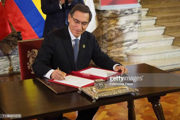 Martin Vizcarra, President of Peru, signing an agreement as part of the activities of the 19th Andean Presidential Council and commemoration of the...