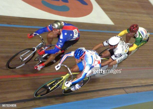 Martin Wayne Nothstein of the USA races his way to win his Keirin first heat ahead of French Laurent Gane 29 August during the World Track Cycling...
