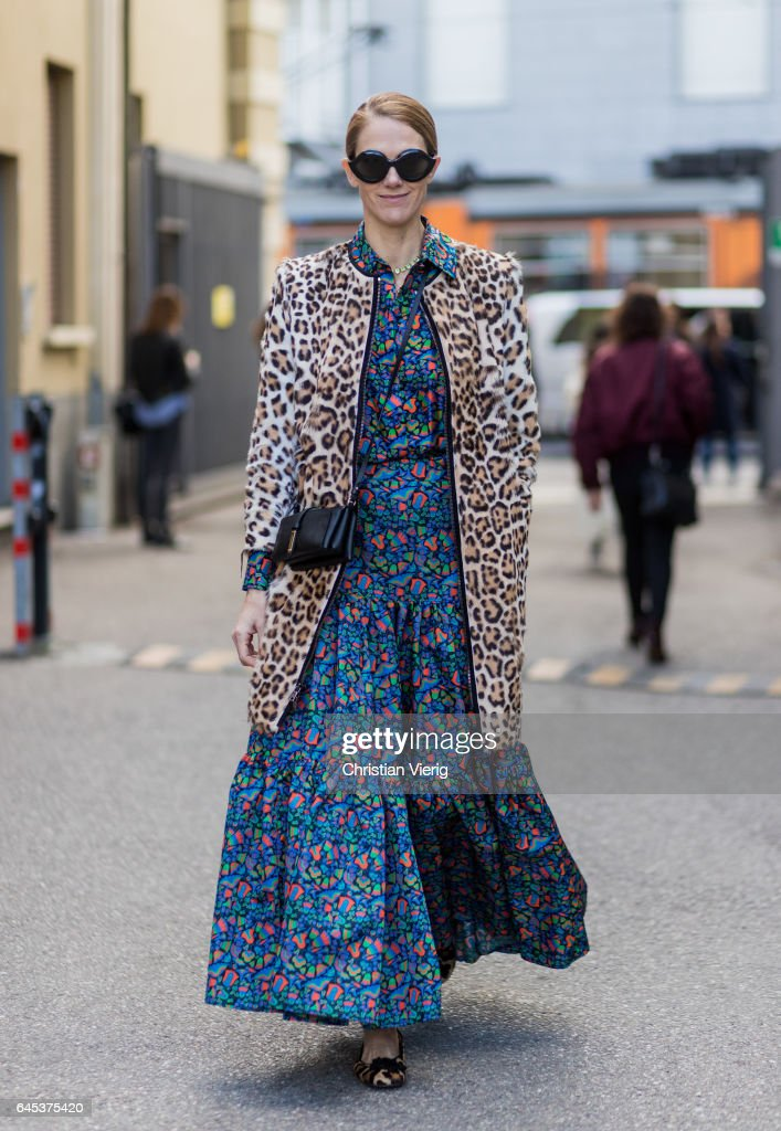 JJ Martin wearing a blue dress with floral print, leopard coat outside Missoni during Milan Fashion Week Fall/Winter 2017/18 on February 25, 2017 in Milan, Italy.