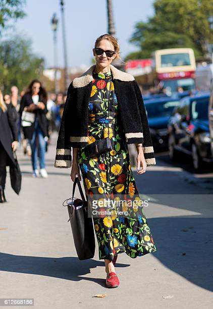 Martin wearing a dress with floral print and jacket outside Chanel on October 4 2016 in Paris France