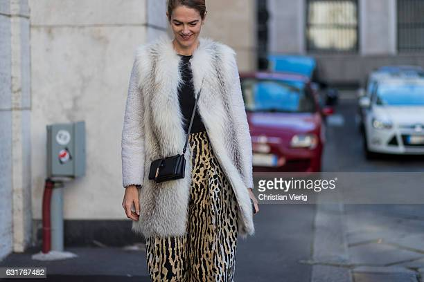 Martin wearing a fur coat leopard print pants during Milan Men's Fashion Week Fall/Winter 2017/18 at Salvatore Ferragamo on January 15 2017 in Milan...