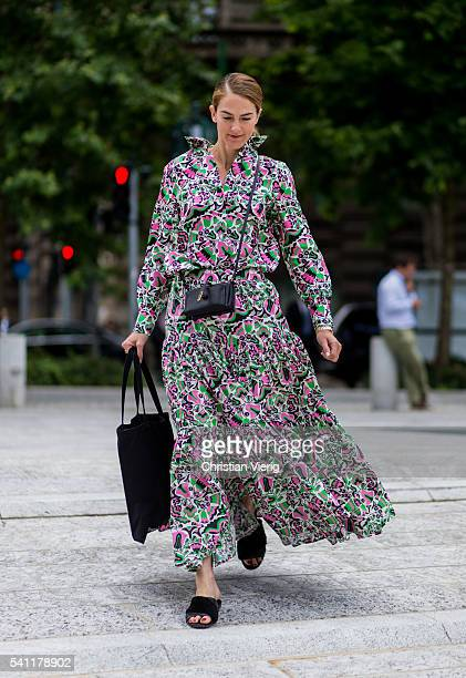 Martin wearing a long dress with floral print outside Versace during the Milan Men's Fashion Week Spring/Summer 2017 on June 18 2016 in Milan Italy