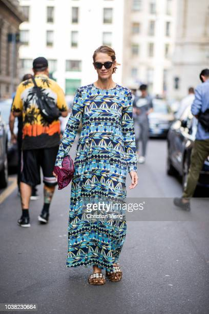 Martin wearing dress with pattern clutch is seen outside Salvatore Ferragamo during Milan Fashion Week Spring/Summer 2019 on September 22 2018 in...