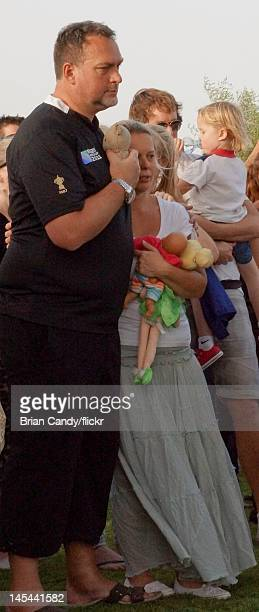 Martin Weekes and Jane Weekes carry toys as they attend a vigil held for their 2 year old triplets Lillie Rhona, Jackson James and Willsher John...