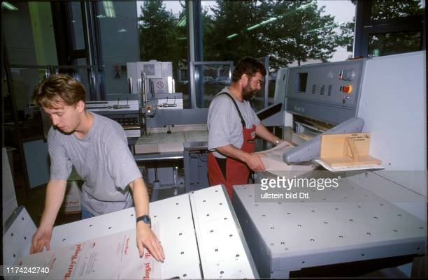 Martin Werder and Urs Bachmann at Polar cutting machine 1997