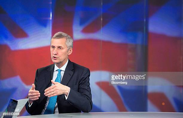 Martin Wheatley chief executive officer of the UK Financial Conduct Authority gestures during a Bloomberg Television interview in London UK on...