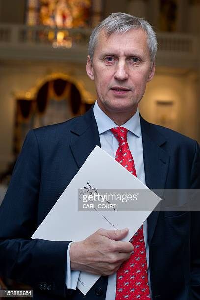 Martin Wheatley Managing Director of the FSA and Chief Executivedesignate of the Financial Conduct Authority poses with a copy of his report that...