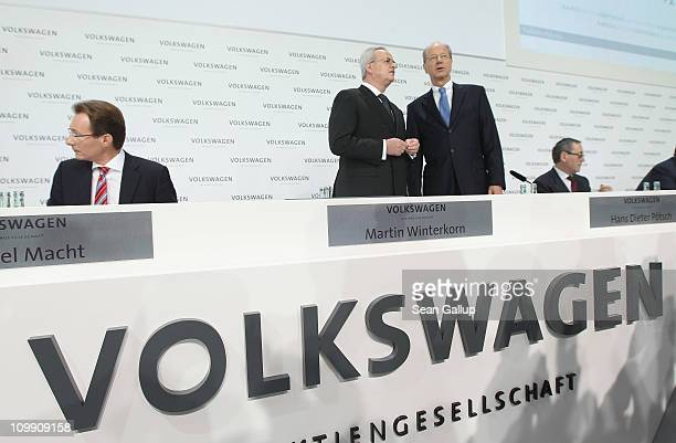 Martin Winterkorn Chairman of German carmaker Volkswagen AG chats with board member Hans Dieter Poetsch upon their arrival at the company's annual...