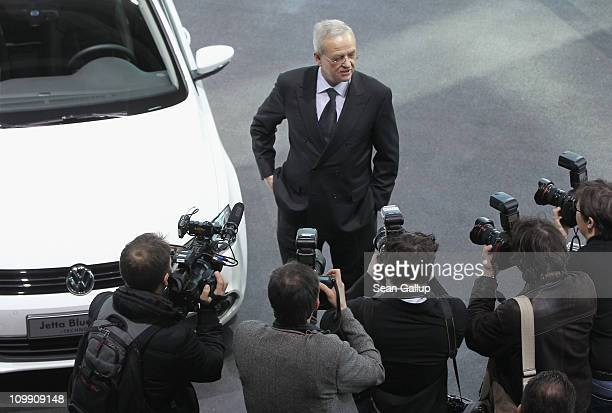 Martin Winterkorn Chairman of German carmaker Volkswagen AG is surrounded by photographers upon his arrival at the company's annual press conference...