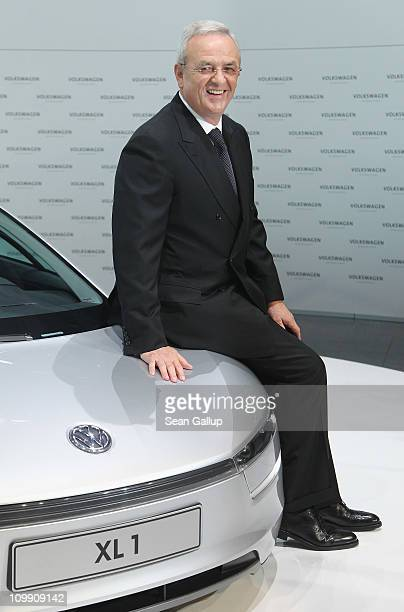 Martin Winterkorn Chairman of German carmaker Volkswagen AG poses with a VW XL 1 prototype highefficiency car shortly before the company's annual...