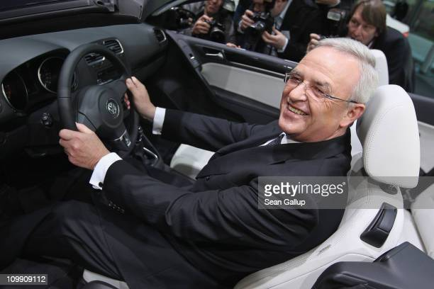 Martin Winterkorn Chairman of German carmaker Volkswagen AG poses in a VW Cabrio car shortly before the company's annual press conference on March 10...