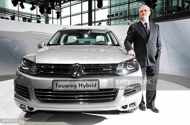 Martin Winterkorn Chairman of German carmaker Volkswagen AG poses next to a VW Touareg Hybrid SUV upon his arrival at VW's annual press conference on...