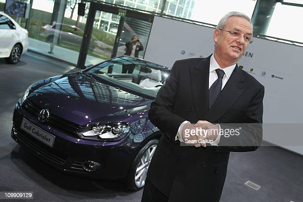 Martin Winterkorn Chairman of German carmaker Volkswagen AG stands next to a VW Cabrio car shortly before the company's annual press conference on...