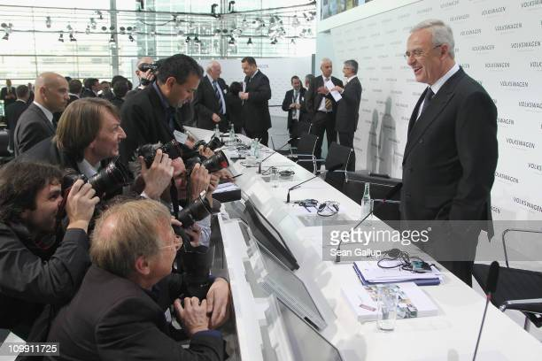 Martin Winterkorn Chairman of German carmaker Volkswagen AGpauses for photographers before departing following the company's annual press conference...