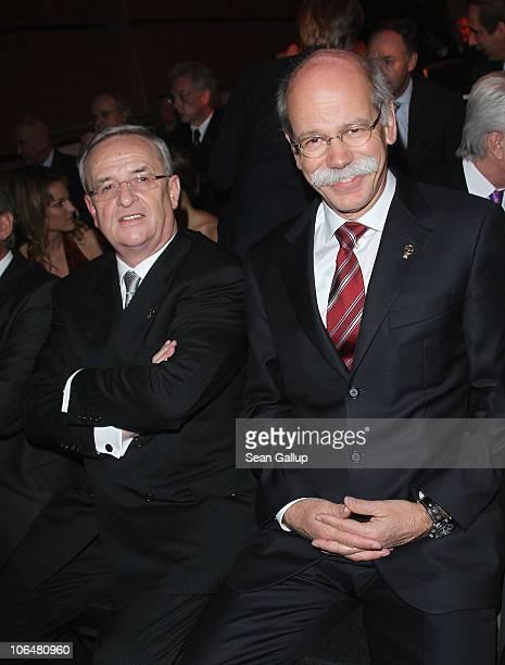 Martin Winterkorn Chairman of Volkswagen AG and Dieter Zetsche Chairman of Daimler AG attend the 2010 Das Goldene Lenkrad awards at Axel Springer...