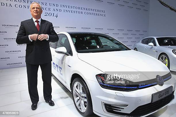 Martin Winterkorn Chariman of the German carmaker Volkswagen AG stands next to a VW GTE as he arrives for the company's annual press conference to...