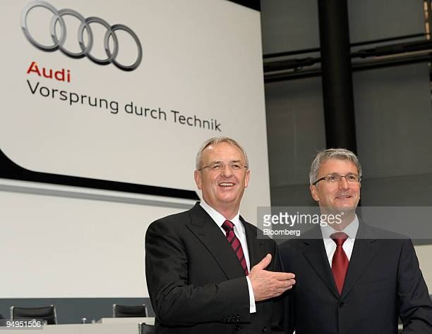 Martin Winterkorn chief executive officer of Volkswagen AG left and Rupert Stadler chief executive officer of Audi AG arrive for the company's 120th...