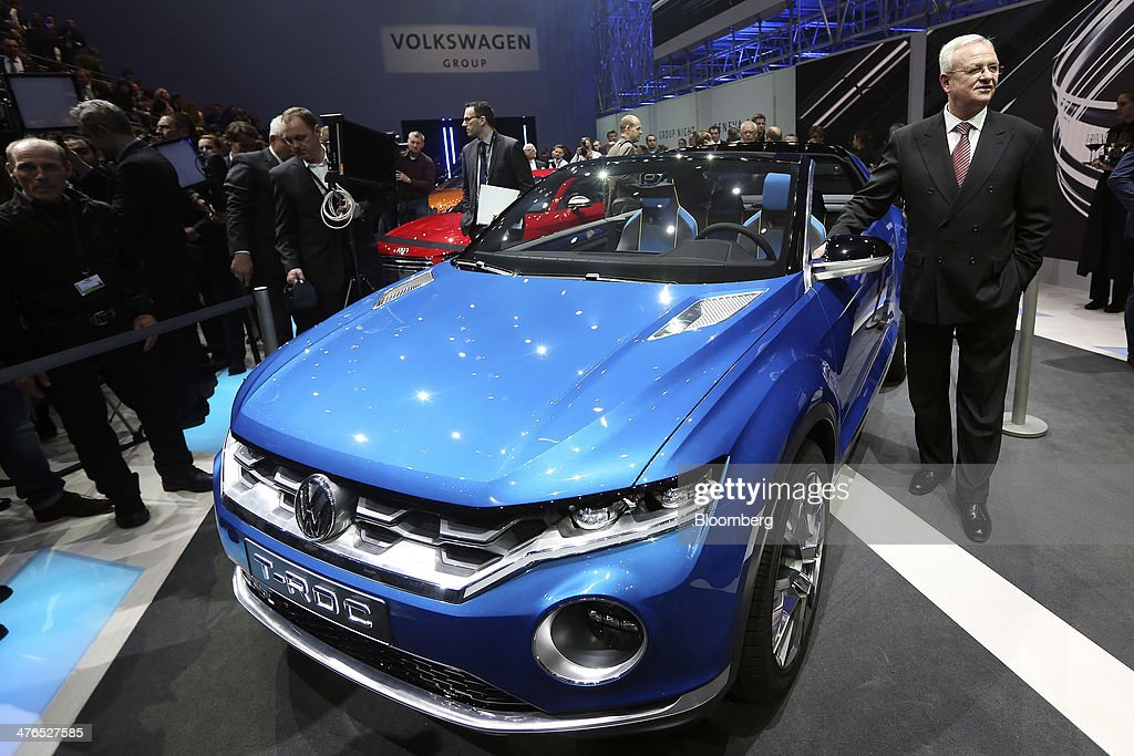 Martin Winterkorn, chief executive officer of Volkswagen AG, poses for a photograph with a T-Roc concept SUV automobile during a news conference ahead of the opening day of the 84th Geneva International Motor Show in Geneva, Switzerland, on Monday, March 3, 2014. The International Geneva Motor Show will run from Mar. 4, and showcase the latest models from the world's top automakers. Photographer: Chris Ratcliffe/Bloomberg via Getty Images