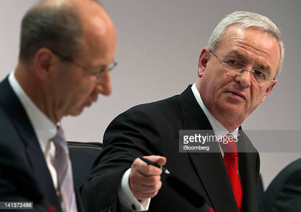 Martin Winterkorn chief executive officer of Volkswagen AG right gestures towards Hans Dieter Poetsch chief financial officer of Volkswagen AG during...