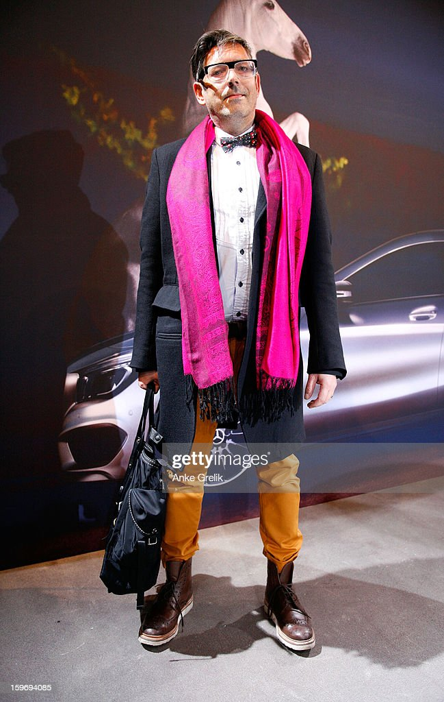 Martin Wuttke wearing Cotton Knowledge trousers ans Grenson boots attends Mercedes-Benz Fashion Week Autumn/Winter 2013/14 at the Brandenburg Gate on January 18, 2013 in Berlin, Germany.